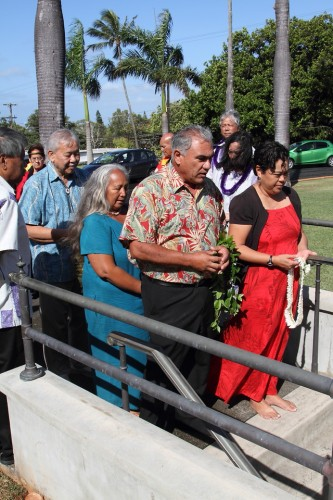 Hawaiian Homes Commission Chair Jobie Masagatani and Deputy to the Chair Bill Aila Jr. present ho'okupu before entering the crypt at the Mauna'ala Royal Mausoleum in Nu'uanu. PHOTO CREDIT: Phil Spalding.