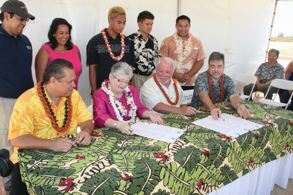 Alapaki Nahale-a, Chairman of the Hawaiian Homes Commission, M.R.C. Greenwood, President of the University of Hawai'i, Clark Llewellyn, Dean, UH School of Architecture, and Peter Crouch, Dean, UH College of Engineering, signed an agreement today at Kapolei which marked a partnership which will allow UH students to actually work on Hawaiian Home Lands homes.