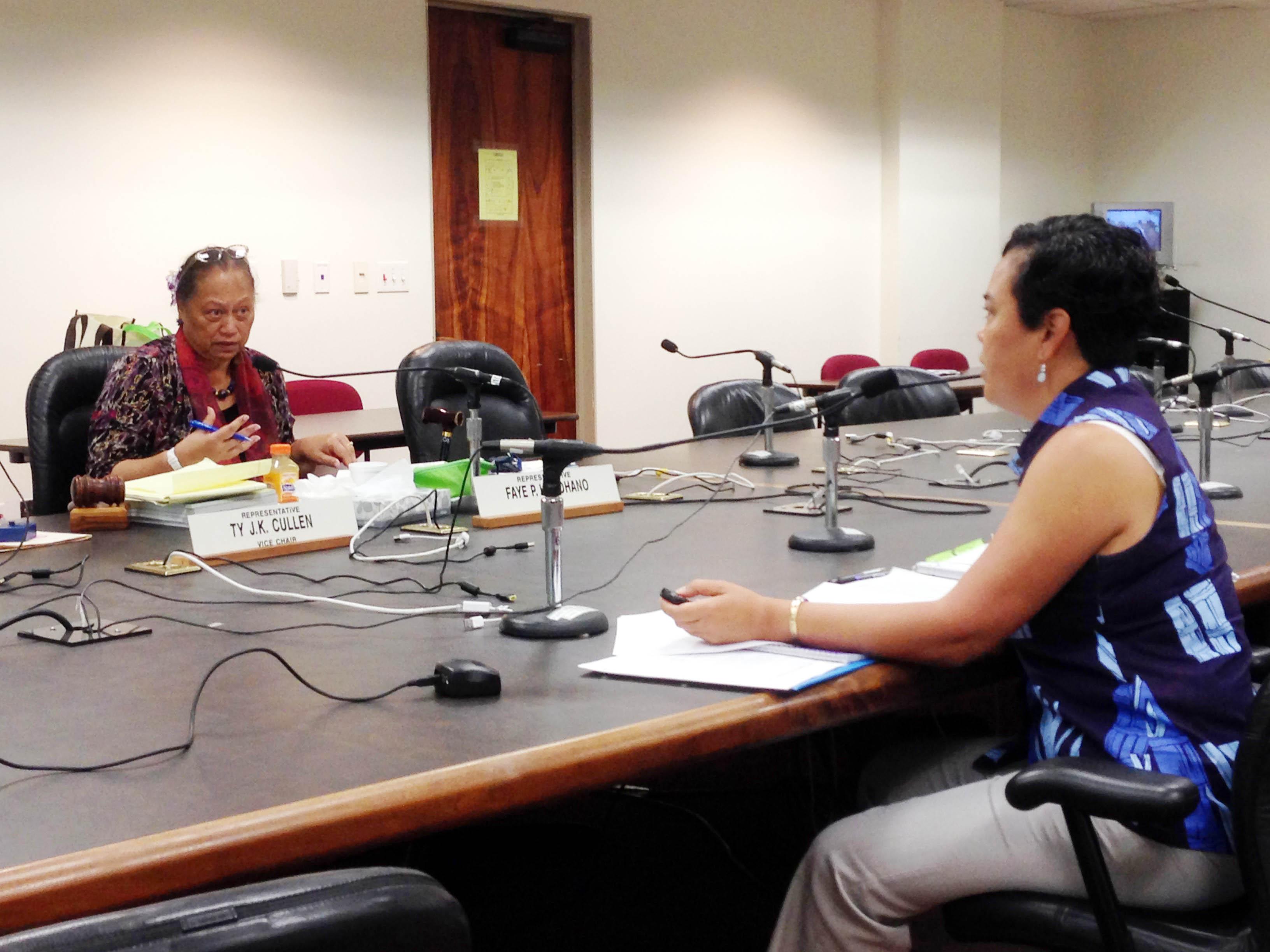 Director Jobie Masagatani answers questions from Rep. Faye Hanohano.