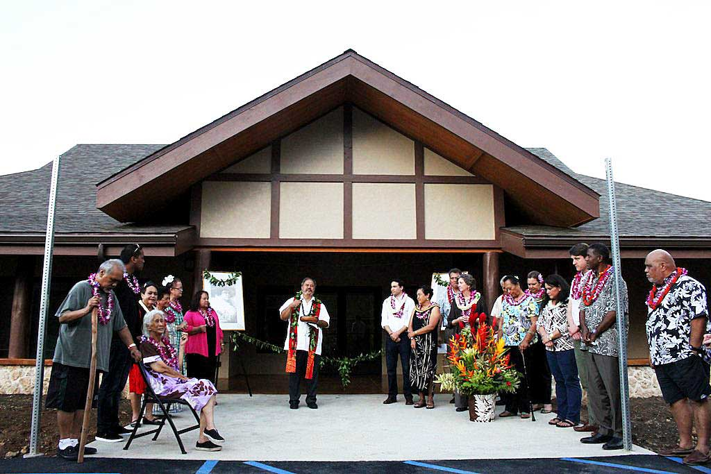 The Waimānalo Hawaiian Homestead Association board, Hawaiʻi legislators, Travois and Pacific Growth Associates gathered at the entrance of the new Waimanālo Community Technology, Education & Employment Center in ceremonies led by Kahu Paul Akau.